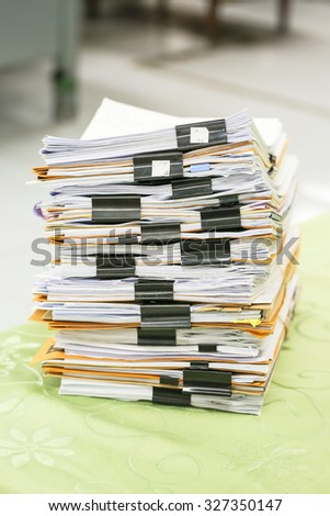 Big stack of business report paper files with black clips - stock photo