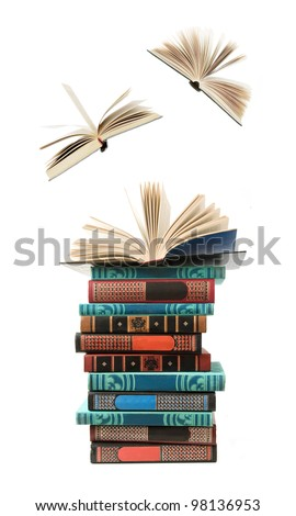 Big stack of old antique books with opened books flying away (education concept) - stock photo