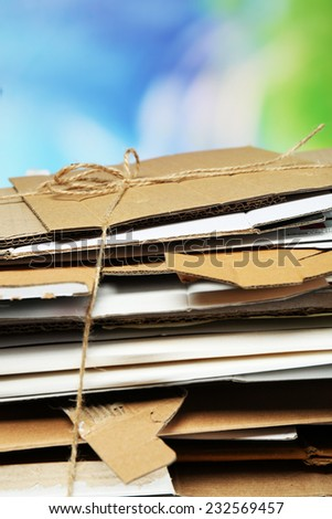 Big stack of papers on blue background, close-up - stock photo