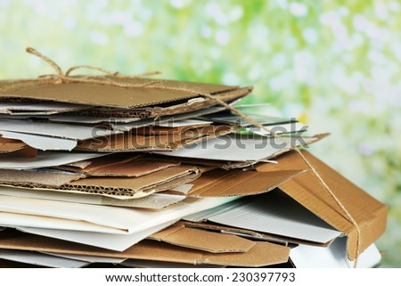 Big stack of papers on green background, close-up - stock photo