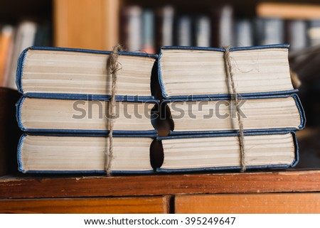 Big stacks of books in the library close up - stock photo