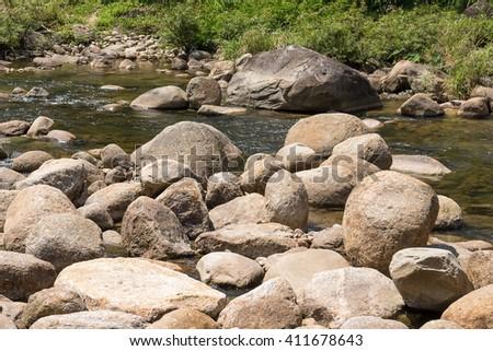 Big stone, pile of rock close river nature. - stock photo