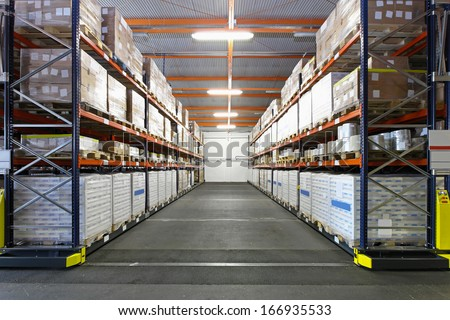 Big storage room for goods in factory - stock photo
