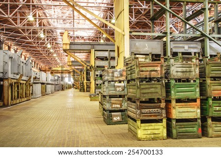 Big storage room with metal boxes in factory - stock photo