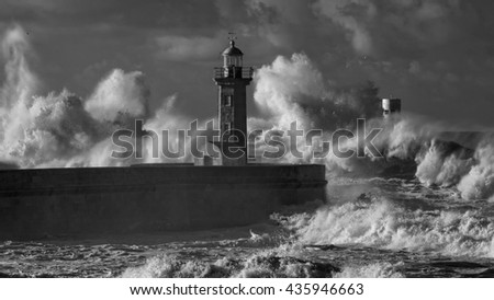 Big stormy waves against old pier and lighthouse of Douro river mouth. Infrared. - stock photo