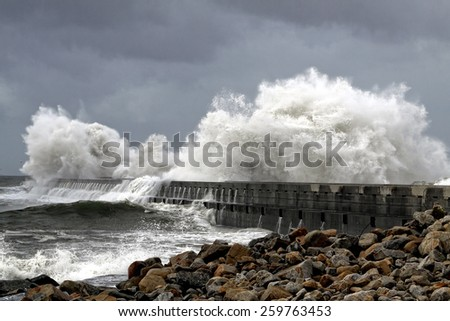 Big stormy waves over  a pier from the north portuguese coast - stock photo