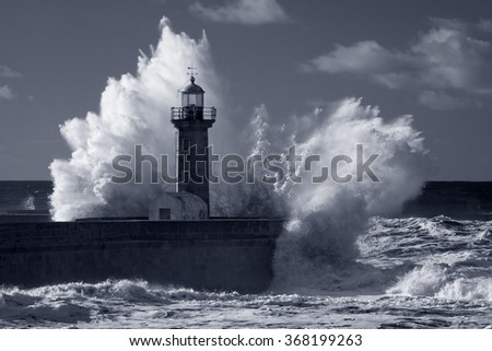 Big stormy waves over old lighthouse and pier of Douro river mouth. Used infrared filter. Toned blue - stock photo