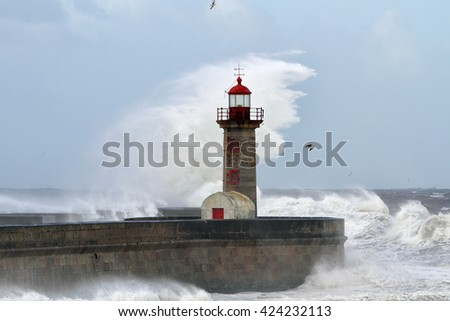 Big stormy waves over old Oporto lighthouse in a windy and stormy beautiful morning - stock photo