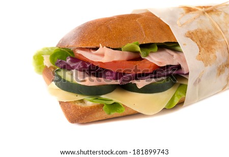Big stuffed sandwich with ham and cheese isolated on white background - stock photo