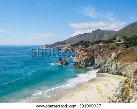 Big Sur is a sparsely populated region of the Central Coast of California where the Santa Lucia Mountains rise abruptly from the Pacific Ocean. - stock photo