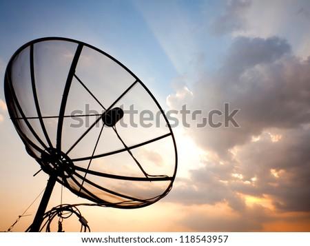 Big telecommunication satellite dish over sunset sky - stock photo