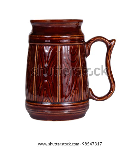Big traditional brown ceramic mug for beer isolated on white background - stock photo