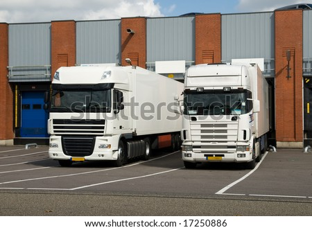 big trucks at a loading dock - stock photo