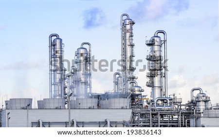 big tube in refinery petrochemical plant in heavy industry estate  - stock photo