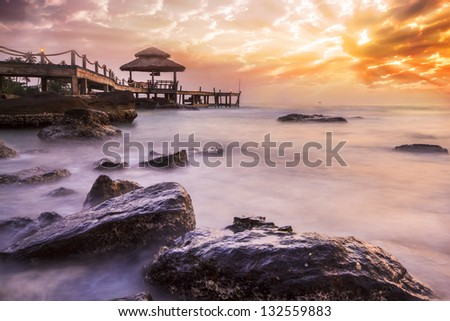 Big wave and the rock with sunset sky at Pattaya beach, Thailand. - stock photo