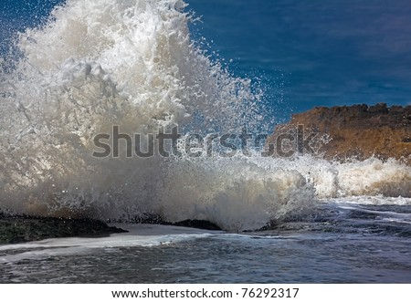 big wave at high tide, beating on the coast (photo) - stock photo