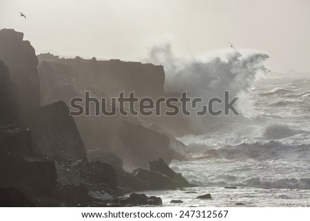 Big waves breaking on cliffs during winter storm on the west coast of Ireland. - stock photo