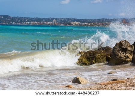 Big waves hitting the rocks - stock photo