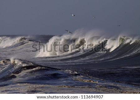 Big waves on the Portuguese coast in a sunny but stormy autumn morning - stock photo