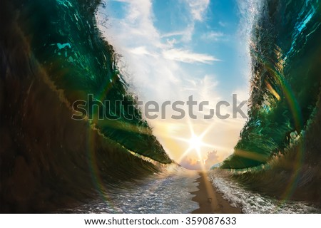 Big waves. Sea parted by a sandy path to the sun with footsteps print on sand - stock photo