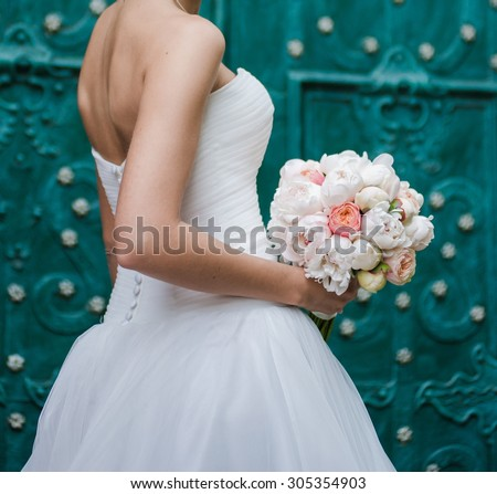 Big wedding bouquet before ceremony. Green background - stock photo