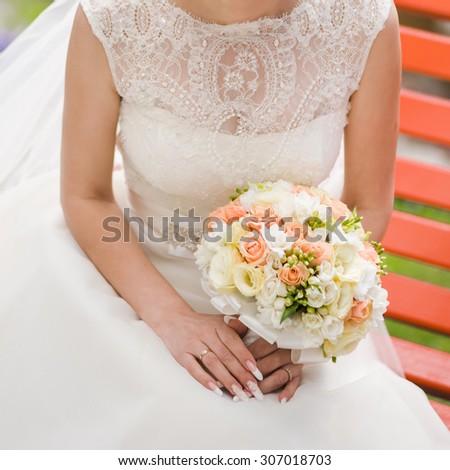 Big wedding bouquet. Groom. Bride. Bridesmaid - stock photo