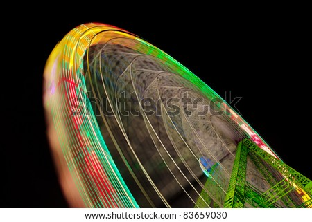 big wheel in motion at night - stock photo