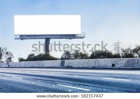 Big white billboard on highway. - stock photo