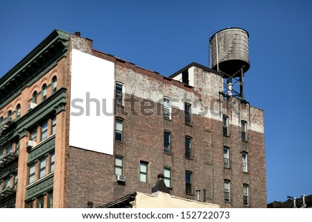 Big, white, blank, billboard on the brick building. - stock photo