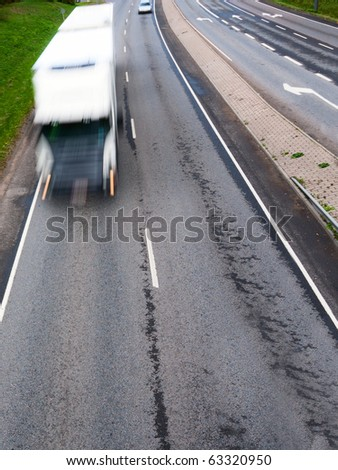 Big white fast moving heavy truck - stock photo