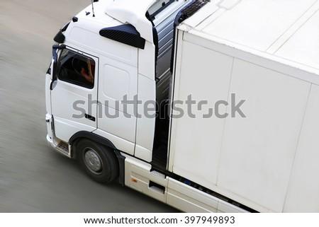 big white trailer transporting cargo  - stock photo