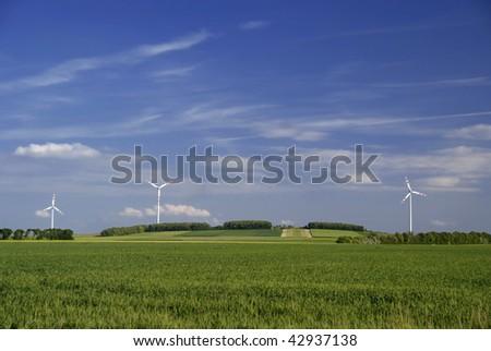 big windmill green field meadow blue sky - stock photo