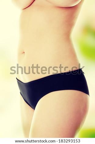 Big woman body on white background  - stock photo