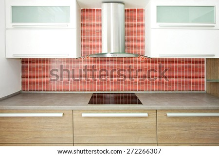 Big wooden counter and red ceramic wall