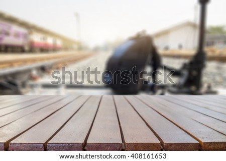 big wooden table of free space and backpack - stock photo