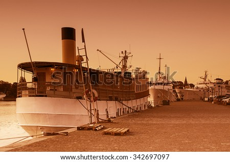 Big yachts in sunrise golden light at the pier in Stockholm - the capital of Sweden - stock photo
