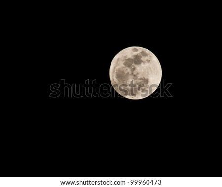 big yellow moon in the black sky - stock photo
