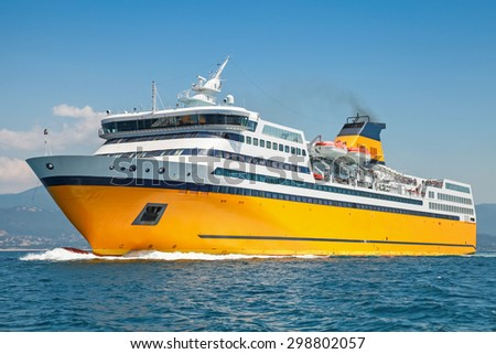 Big yellow passenger ferry goes on the Mediterranean Sea - stock photo