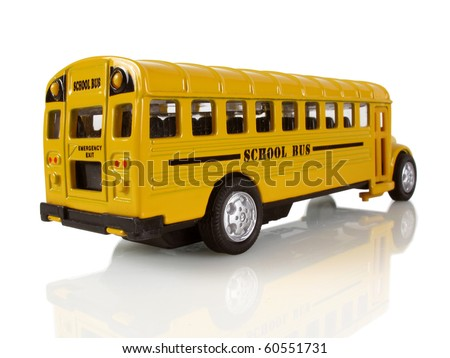 Big yellow school bus on a white reflective background - stock photo
