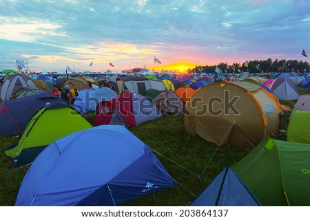 "BIG ZAVIDOVO, RUSSIA - JULY 4: Campsite on open-air rock festival ""Nashestvie"" on July 4, 2014 in Big Zavidovo, Russia. ""Nashestvie"" is the biggest rock festival in Russia, more than 200000 visitors - stock photo"