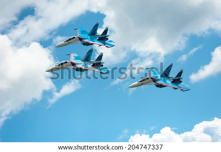 "BIG ZAVIDOVO, RUSSIA - JULY 5: Group of russian military jets Su 27 performs at open-air rock festival ""Nashestvie"" on July 5, 2014 in Big Zavidovo, Russia. - stock photo"