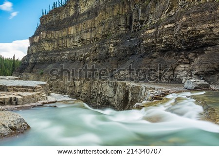 Bighorn River canyon and crescent falls in canada - stock photo