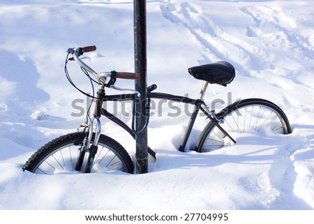 Bike covered by snow - stock photo