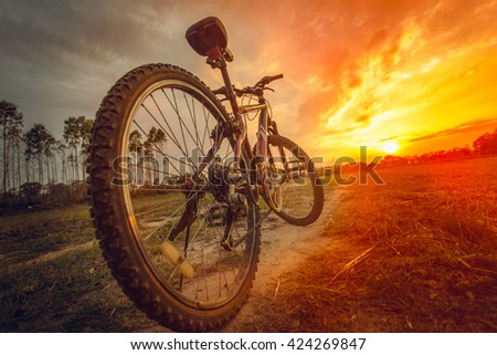 Bike in the sunshine in the afternoon. - stock photo