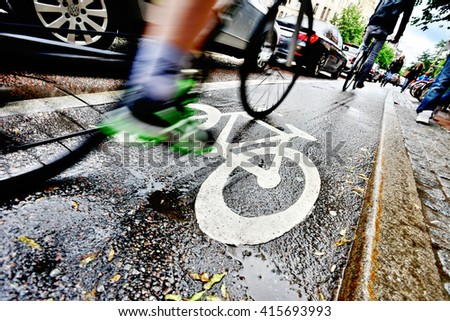 Bike lane and car queue - stock photo