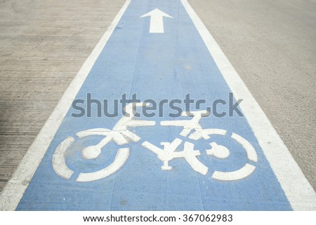 Bike lane, Arrow and bycicle sign on lanes road, Bike lane in city street. - stock photo