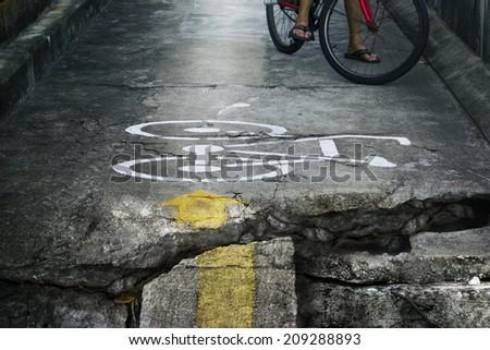 Bike lane broken and crack endangering - stock photo