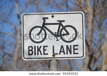 bike lane sign shows the way for bikes - stock photo