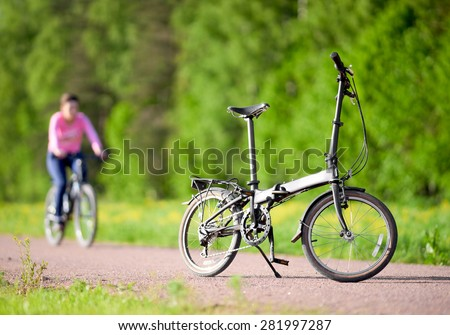 Bike on the road in the park - stock photo