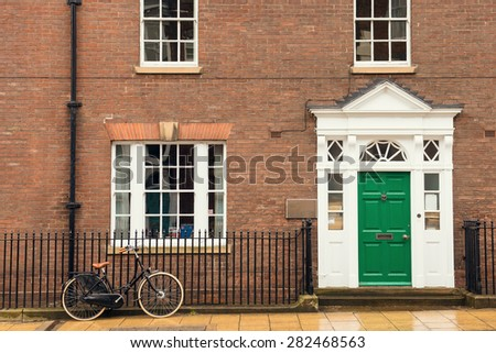 Bike parked in the city with a beautiful building behind. - stock photo